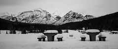 Lovely day for a picnic (chrisroach) Tags: alberta mountains countries canada banffnationalpark lakeminnewanka snow bench banff winter blackandwhite blackwhite bw monochrome