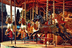 20101214h Golden Carousel ([Ananabanana]) Tags: d40 gimp photoscape 1855mm 1855 nikkor nikon1855mmkitlens nikkorafsdx1855mm nikonafsdx1855mm nikkor1855mm nikon1855mm nikonistas nikonista uk unitedkingdom kent medway castle norman rochester festive christmas yule merrygoround carousel fair fairground ride horse horses red yellow gold golden nikon