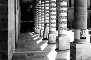 Against the column