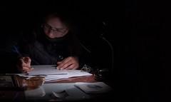 A través de una pequeña lámpara una mujer escribe entre papeles (jimenez.juan78) Tags: pontevedra pwmelilla