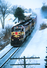 Cresting Lomira (view2share) Tags: wc wc6553 wc3027 flag flags flagunit wisconsincentral southbound eastbound emd electromotivedivision engine evening sd45 gp40 chicagosub waukeshasub byron byronhill lomira wisconsin wi winter snow snowfall cold fallenflag deansauvola dusk february42003 february2003 february 2003 railway railroading rr railroads railroad rail rails railroaders rring roadtrip track transportation trains tracks train transport trackage trees travel freight freighttrain freightcars freightcar