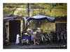 Street scene, Vietnam (jen 3163) Tags: hoian vietnam streetscene bicycles hats wall
