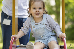 On the slide (Adrienn723) Tags: outside outdoor nature naturaleza green verde trees leaves flowers child children girl baby kid young bebé hija bambina bambino family love happiness play plying smile laugh swing slide portr familia amor felicidad sonrísa