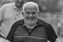 Happiness is infectious (Frank Fullard) Tags: frankfullard fullard candid street portrait smile happy monochrome blackandwhite blanc noir face castlebar mayo pinkribbon walker cyclist irish ireland