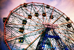wonder wheel at dusk (lomokev) Tags: pink blue sunset newyork colour brooklyn clouds coneyisland amusement lomo lca xpro lomogr