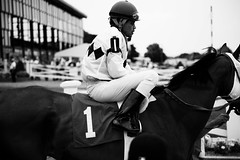 jockey.jpg (binkybink) Tags: horses people blackandwhite bw gambling boston canon track documentary racing 5d scenes suffolkdowns alisongrippo