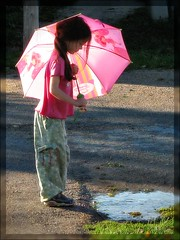 Ember's Pink Umbrella (m00nbugg) Tags: pink sunlight kids umbrella children puddle