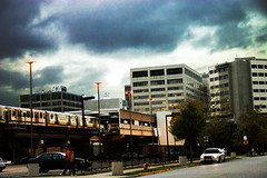 Metro Stormy (Michael DaKidd) Tags: city autumn sky urban chicago storm building nature weather architecture clouds train work buildings skyscape outdoors rebel pretty cityscape gloomy gbrearview darkness natural outdoor foreboding terminal architectural depot commuter civic transition chicagoist