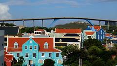 WILLEMSTAD, CURACAO (pwitterholt) Tags: koninginjulianabrug curacao willemstad caribischezee stannabaai bridge brug pastel otrobanda traffic canon canoneosm3 queen harbour haven