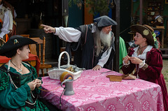 Older Man Expressively Talking to the Young Woman (Kevin MG) Tags: people costure renaissancefaire renaissance renfaire faire costumes actors performers man women
