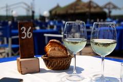 Fregene @La scialuppa (Francesco Dini) Tags: mare sea seaside beach sand spiaggia fregene onde waves blu azul azzurro wine vino food