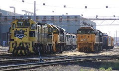 T385 T363 XR555 XR557 and a line up of A classes stabled at South Dynon (bukk05) Tags: aat22c2r emd12645e3b g8b emd8567cr t385 t363 tclass railpage:class=7 railpage:loco=t385 rpauvictclass4 rpauvictclass4t385 xr557 xr555 emd16645e3c aclass explore export engine emd electromotivediesel railway railroad railpage rp3 rail railwaystation railwaystations train tracks trains tamron tamron16300 yard photo photography loco pn pacificnational pnruralbulk hp horsepower flickr freight diesel station summer 2018 australia zoom canon canon60d clyde clydeengineering victoria vr vline victorianrailway victorianrailways southdynon melbourne bg broadgauge xrclass