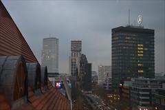 Berliner dusk (angelsgermain) Tags: view dusk overcast mist sky lights buildings ads roofs streets cars trees church breitscheidplatz kaiserwilhelmgedächtniskirche kadewe city berlin deutschland germany