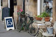 On your bike... (Blue sky and countryside) Tags: matlock derbyshire restaurant theremarkablehare sunday lunch goodfood england springtime sun vintageitems menu logo pentax vintagecycle basketofflowers timelesscharm