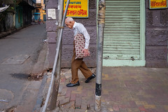 Confined (SaumalyaGhosh.com) Tags: confined man old age down street character streetphotography kolkata india color