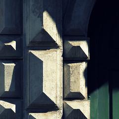 catania (caeciliametella) Tags: lorrainekerr photography 2016 catania palazzo angiò shadow rustication nailhead green deep ombra verde sicily sicilia palazzogioenidangiò viaetnea door portone stone