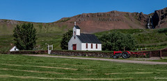 Staðarkirkja á Reykjanesi 1864 ( Reykhólasveit ) 2 (einisson) Tags: staðarkirkja church reykhólar waterfall house tractor mountain trees grass outdoor landscape einisson canon70d iceland