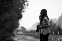 Shooting the Candid-Photographer (PB2_2498) (Param-Roving-Photog) Tags: woman wife photographer camera road traffic bus candid streetphotography pretty beauty monochrome blackandwhite bw nikond7200 tamron150600 bokeh depthoffield