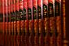 Jules V (Pi-F) Tags: livre couverture cuir dos rouge julesverne dorure noir dof blur bokeh bibliothèque collection étagère