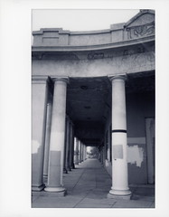 Niland Colonnade (tobysx70) Tags: instax fujifilm fuji wide monochrome bw black while instant film 500af camera colonnade main street niland california ca shops store closed abandoned vanishing point salton sea mojave desert polaroadtrip polawalk 030718 toby hancock photography