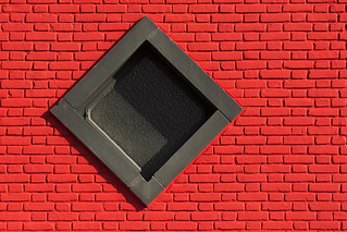 Red wall and black window