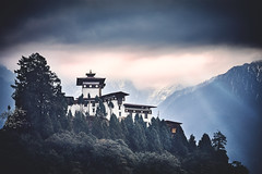Bhutan: Gasa Dzong. (icarium82) Tags: bhutan travel canoneos5dmarkiv analogefex architecture buddhist canonef85mmf12lii captureone clouds dramaticsky forest gasavalley himalayas layers leefilters mountainrange mysterious mountains mystical peaks dzong sunburst