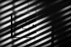 The light (and shade) switch. (Steve.T.) Tags: blackandwhite bnw shade shadow blind stripes lines lightandshade lightswitch nikon d7200 sigma18200 venetianblind diagonallines mono