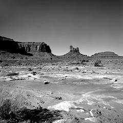 Barren Waste (Scott Holcomb) Tags: monumentvalley navajonation arizona hasselblad500c carlzeisssonnar14f150mmlens zenzabronica67mmso56•2cya3filteradapter adoxchs25artfilm 120film 6x6 squareformat epsonperfectionv600 photoshopdigitalization