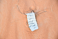 Note in the Sand (meg21210) Tags: arabic sahara desert morocco note paper sand abandoned lost