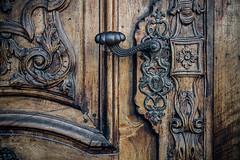 Without that piece (Melissa Maples) Tags: innsbruck österreich austria europe nikon d3300 ニコン 尼康 nikkor afs 18200mm f3556g 18200mmf3556g vr winter church university johannesvonnepomuk brown wooden wood handle door