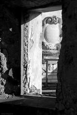 Beyond the window (Darea62) Tags: window art architecture angel sculpture ancient history seravezza azzano versilia tuscany annunziata church lacappella marble marmo arms shield sunshine decay