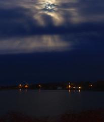 P5010500 (Paul Henegan) Tags: 67cropvertical beltane fortpond montaukny moon clouds longexposure night reflections shore spring streetlights waninggibbous