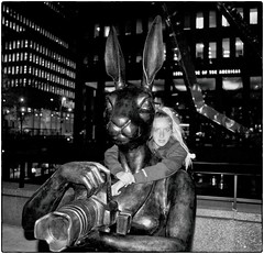 Portrait With a Rabbit (Steve Lundqvist) Tags: new york usa states united america manhattan stati uniti travel trip viaggio model urban city urbanscape portrait ny nyc persone ritratto ambient light fashion moda mood attractive beauty streetphotography sportwear streetwear kid path strada pet statue monument camera girl nikon d700 ragazza rabbit photographer