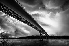 Under the bridge (Ben Melander Photo (BM Photo)) Tags: bridge moody clouds blackandwhite ice winter frozen sea overpass connecting lookup sony a7ii batis18 draama