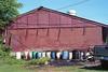 Color barrels (ADMurr) Tags: dab160edit ms clarksdale color barrel water town red wall cinder blocks leica m6 50mm summicron kodak film