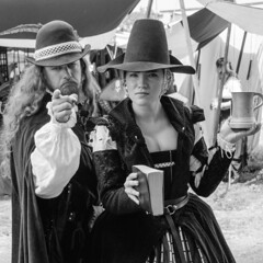 """Repent Ye Sneaky Soul Stealer"" (BW) (Kevin MG) Tags: renfaire renaissancefaire irwindale puritans blackandwhite bw blackwhite religious man woman adult costumes acting"