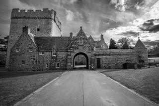 the fine art black & white gate of Drum castle is wide open, vanishing point, Aberdeenshire, Scotland