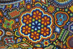 huichol texture (ikarusmedia) Tags: texture huichol art artcraft chaquira beads cactus bird serpent sun figures eagle peyote reforma mexico city