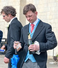 A Champagne Conundrum (sasastro) Tags: streetphotography candid people champagne suit wedding norwich pentaxk5iis pentax50135f28