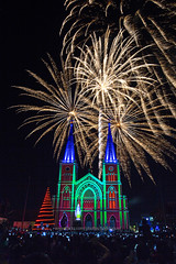 Christmas fireworks over colorful Chanthaburi Cathedral. (baddoguy) Tags: above ancient civilization architecture arts culture entertainment audience bright building exterior built structure cathedral celebration christmas decoration lights church color image communication cultures exploding fairy tale famous place fantasy firework explosive material display gothic style happiness holiday event igniting illuminated incidental people joy local landmark media equipment multi colored national night noise outdoors photo messaging photography projection mapping religion showing sky telephone thai thailand tourism tradition travel destinations using phone vertical