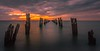 Piering to the horizon... (Goldmanoz) Tags: cliftonsprings bellarinepeninsula geelong thedell sunset ocean pier ruins sea beach wood posts water sky clouds twilight