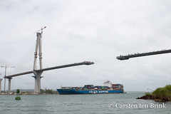 Atlantic Bridge under construction and container ship (10b travelling / Carsten ten Brink) Tags: carstentenbrink 10btravelling 2018 americas atlantic atlanticbridge caribbean centralamerica iptcbasic latinamerica latinoamerica panama panamacanal panamá vinci bridge centroamerica cmtb construction incomplete ocean tenbrink underconstruction