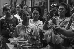 incense offering or photo op (Stitch) Tags: streetphotography chinesenewyear chinatown binondo luckychinatown mall incense offering manila philippines bw blackandwhite people chinese streetshot weekly