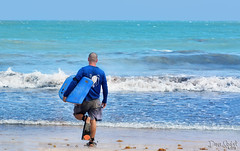 Entering the surf zone (Isabel_Echevarria) Tags: bodyboarding water waves surf blue sky set ready strong man beach tropical island puerto rico