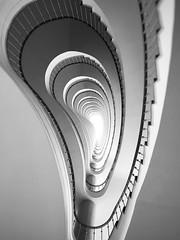Treppe im Ohr / Can you hear me (Sockenhummel) Tags: treppe stairs stairway treppenhaus berlin schwarzweis monochrom staircase stairwell spirale architektur architecture blackwhite ohr ear iphone snapseed fokuseffekt escaliers stufen steps