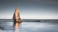Standing alone. (Nathan J Hammonds) Tags: lone rock stone dorset uk sea water coast alone long exposure 10stop nd filter nikon d750 sky seascape landscape simple sunset calm