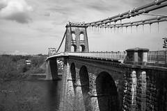 L2018_1071 - Menai Suspension Bridge - Anglesey (www.jhluxton.com - John H. Luxton Photography) Tags: 2018 a5 a5londontoholyheadroad bangor cymru gwynedd johnhluxtonphotography leica leicam leicamtyp262 londontoholyheadroad menai menaibridge menaistrait menaisuspensionbridge pontgrogyborth porthaethwy thomastelford wales ynysmôn bridge road roadbridge roadtransport suspensionbridge wwwjhluxtoncom blackandwhite monochrome
