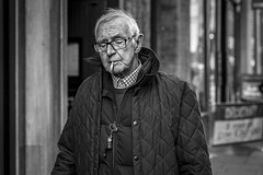 Stub (Leanne Boulton) Tags: portrait urban street candid portraiture streetphotography candidstreetphotography candidportrait streetportrait streetlife old elderly man male face expression mood smoke smoker smoking cigarette tone texture detail depthoffield bokeh naturallight outdoor light shade city scene human life living humanity society culture people canon canon5d 5dmkiii 70mm ef2470mmf28liiusm black white blackwhite bw mono blackandwhite monochrome glasgow scotland uk