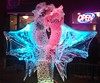 Ouroboros (Ean Morgan) Tags: fireandice fireandicefestival neon glow ice sculpture statue red blue pink open sign wings monster creature dragon ouroboros icesculpture carved carving loveland colorado northerncolorado unitedstates color light eanmorgan elspethmorgan mitresquaremurder