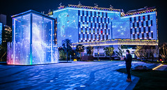 Close encounters (Phg Voyager) Tags: light night outdoor fun color urban city boy laser xian china leica mp 24mm summilux phgvoyager nice photography cube blue alone jellyfish building water fountain ologram